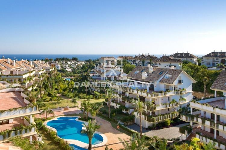 Apartment with private garden in a residential complex in Marbella