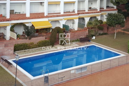 Apartments in a residential complex with pool.
