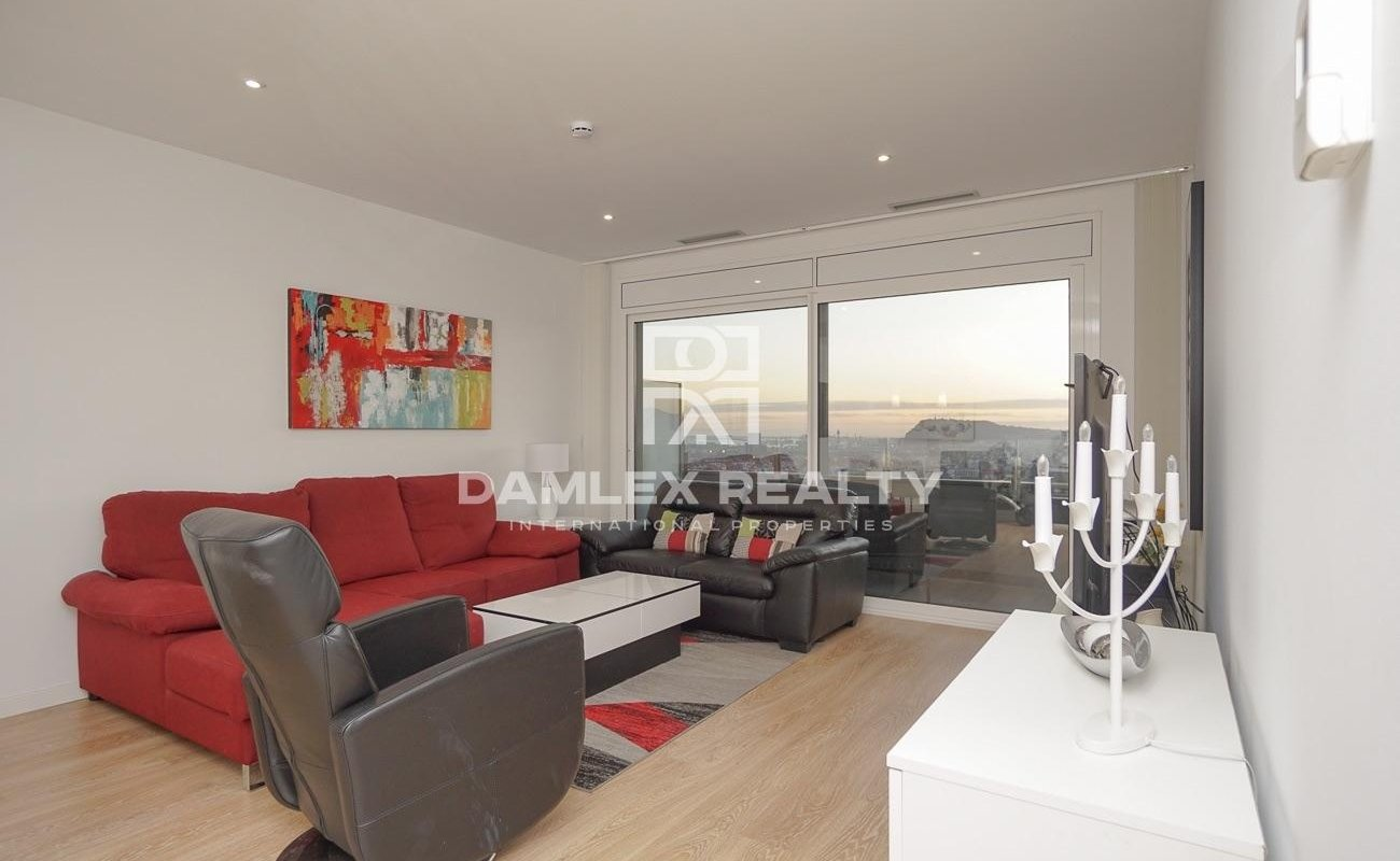 Apartment in a new building with stunning views of Barcelona and the sea.